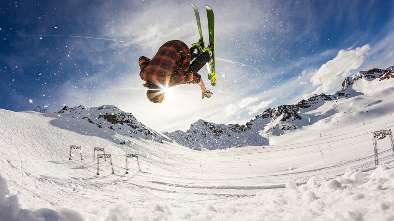 Man Doing Front Flip While Skiing